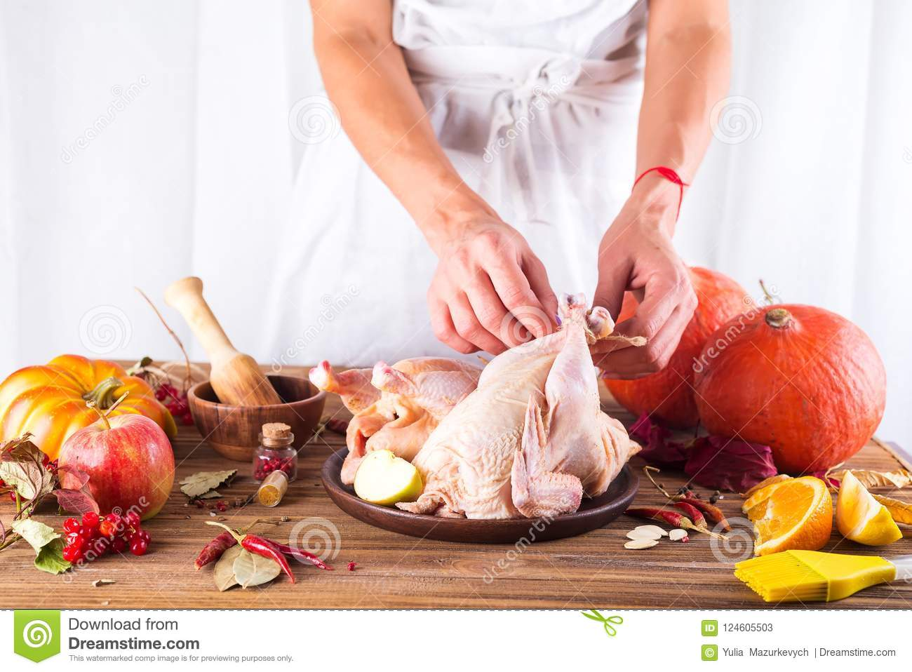 Raw Chicken In A Plate With Apples, Oranges And Spices On A
