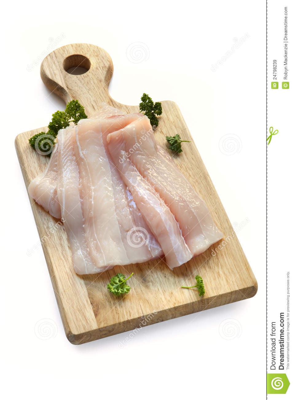Raw fish fillets on board over white royalty free stock for Fish fillet board