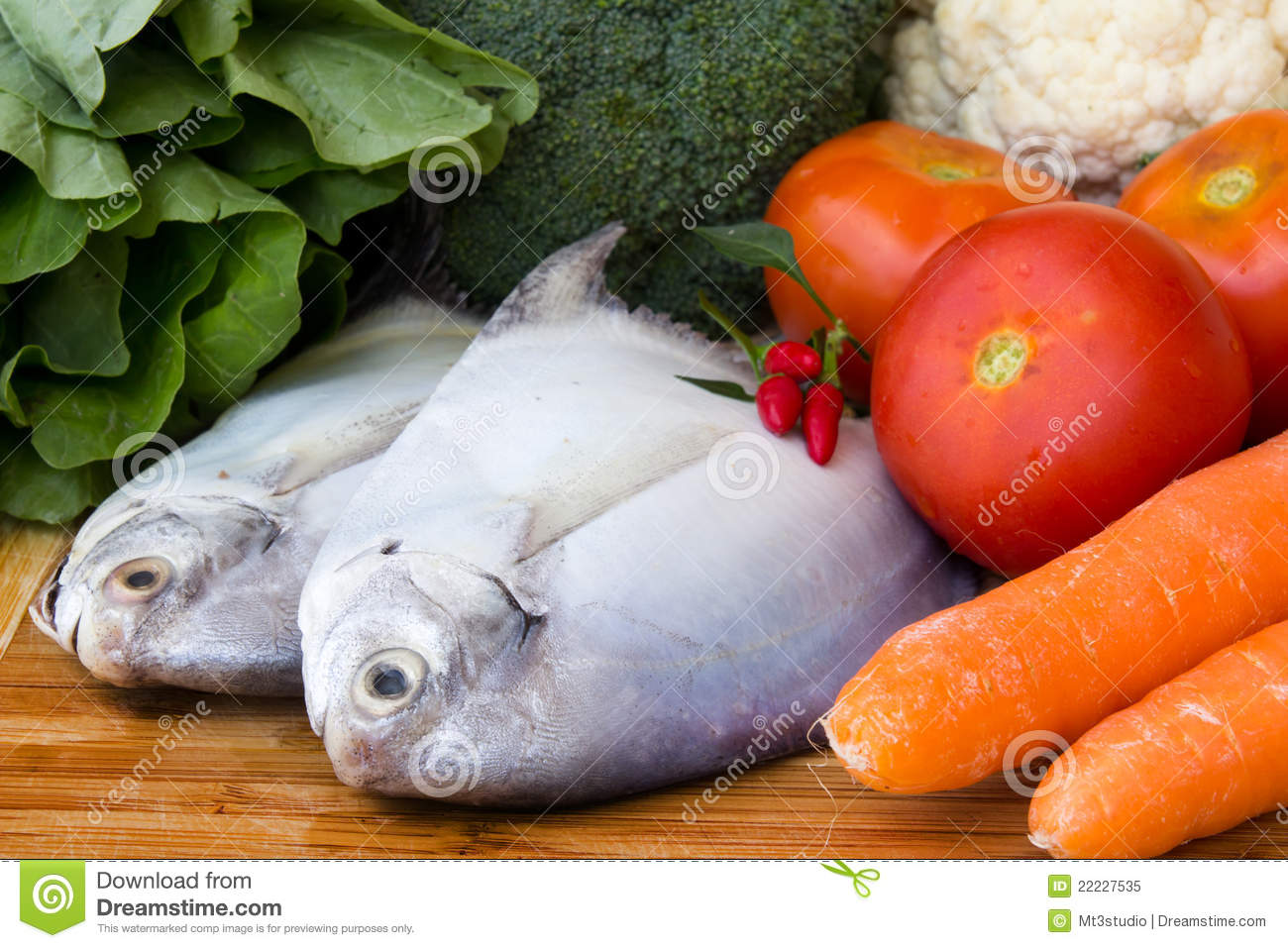Raw fish with fresh vegetables stock image image 22227535 for What vegetables go with fish