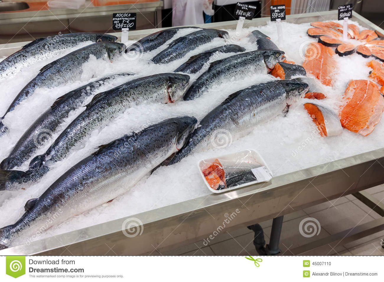 Raw fish in ice ready for sale at the supermarket