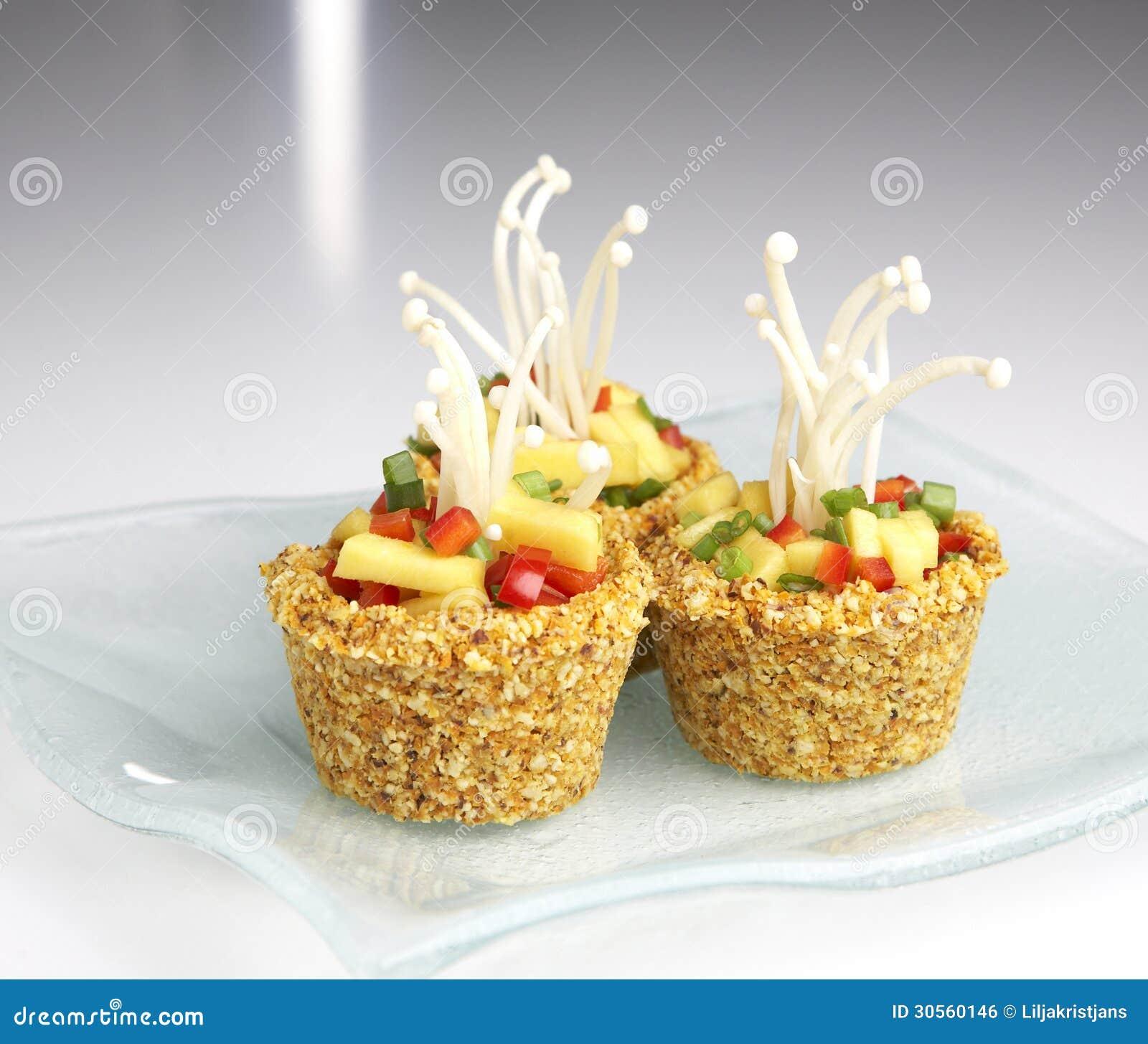 Raw food shells stuffed with raw food formed like a cupcake.