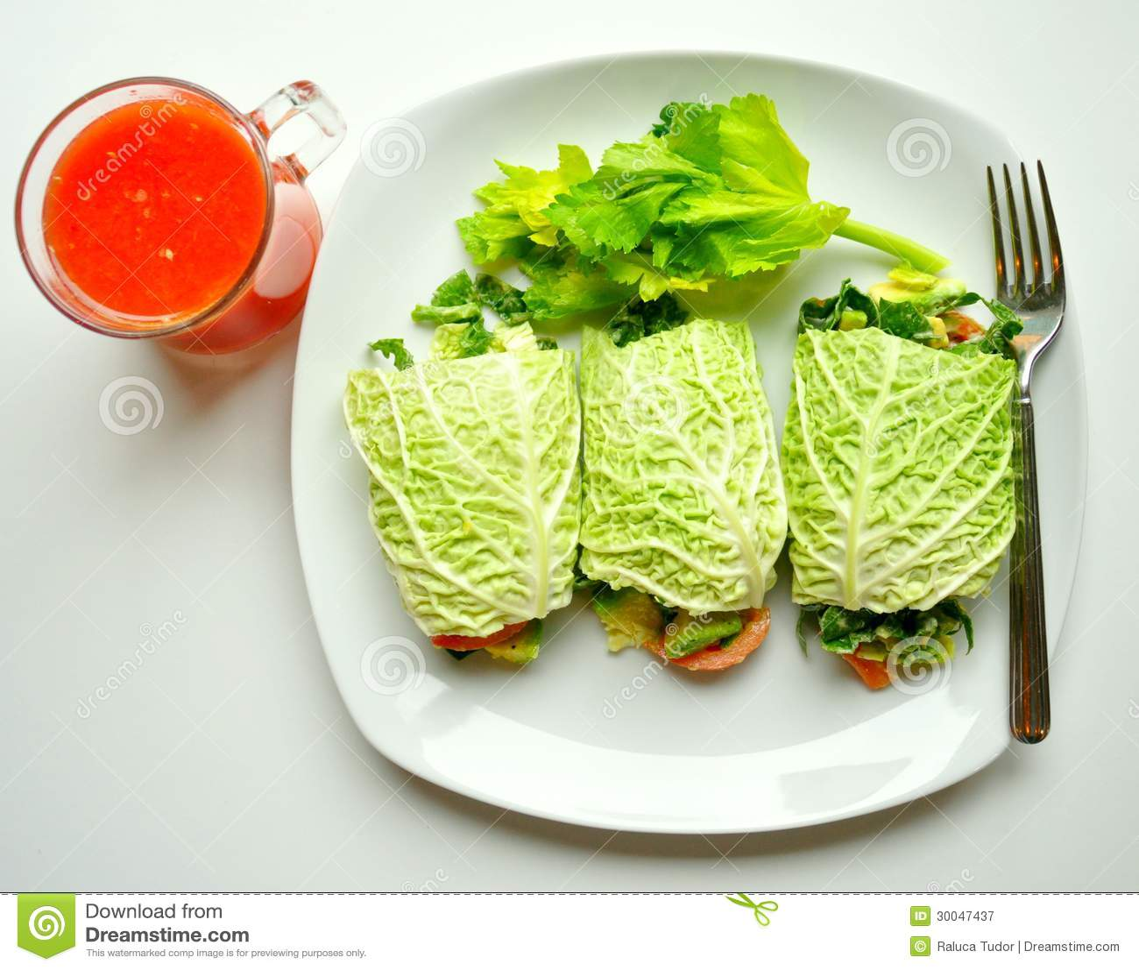 Detox diet with raw vegan rolls and red orange juice
