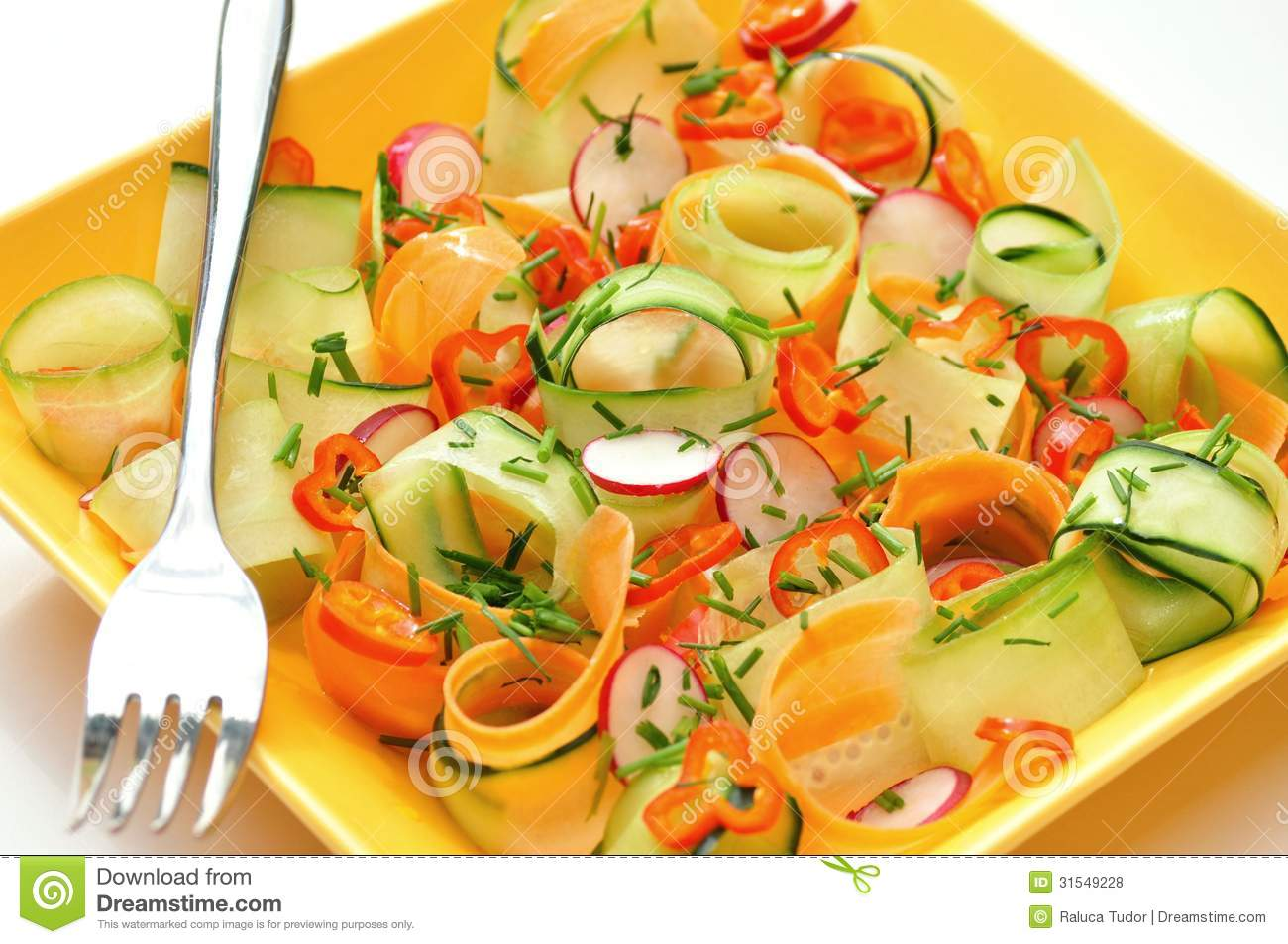 Raw food salad with carrots and cucumber