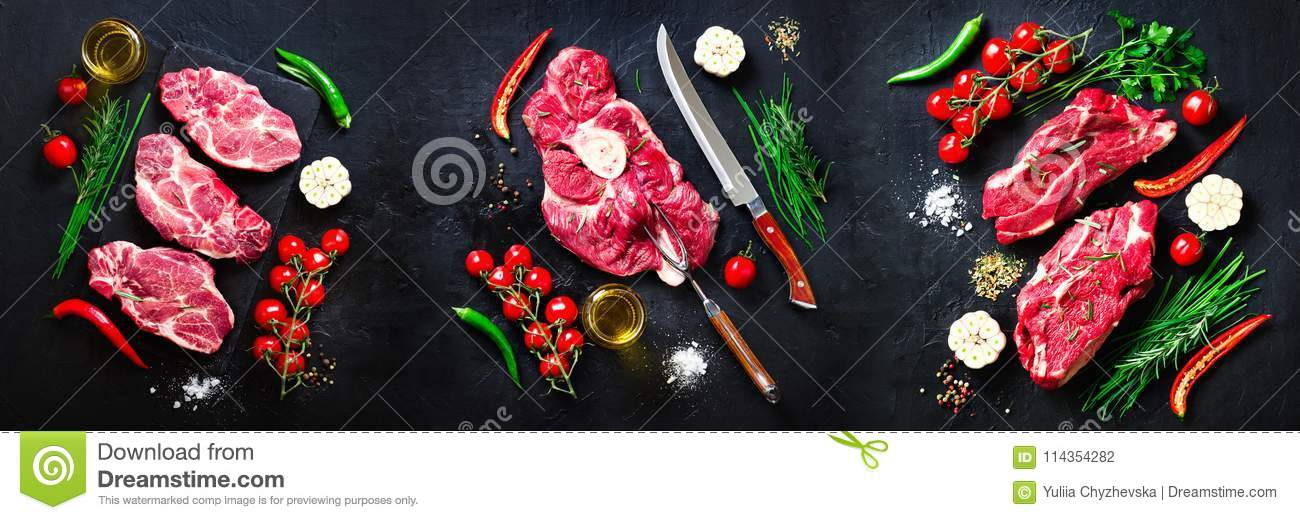 Raw fresh meat steak with cherry tomatoes, hot pepper, garlic, oil and herbs on dark stone, concrete background. Banner.