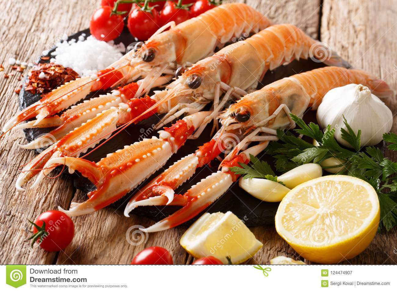 Raw fresh Nephrops norvegicus, Norway lobster, Dublin Bay prawn, langoustine or scampi close-up with ingredients. horizontal