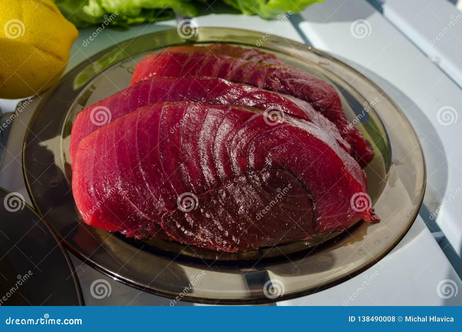Raw fresh tuna steaks on the plate