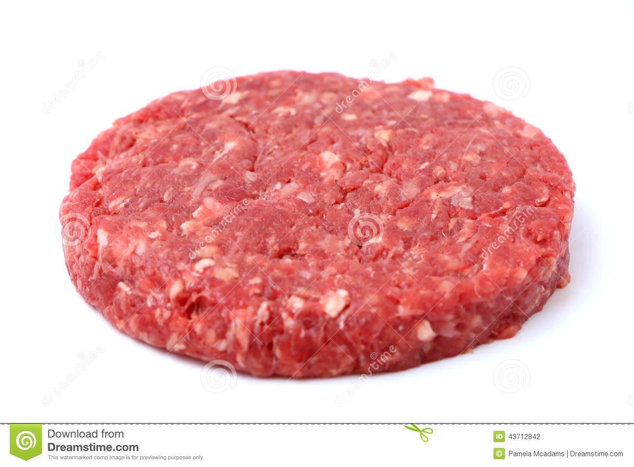 Raw hamburger patty isolated on a white background.