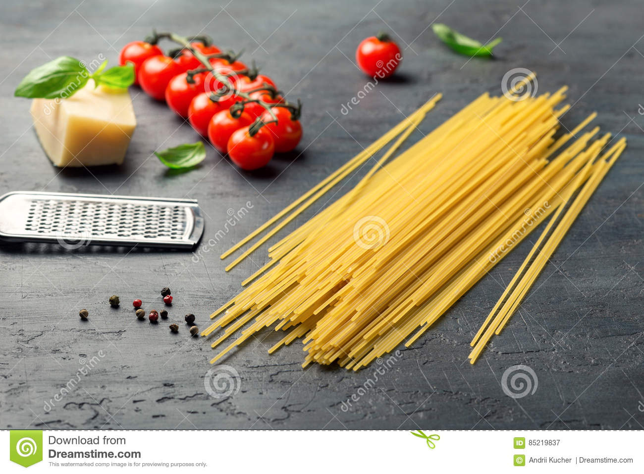 Raw Italian spaghetti with ingredients for cooking classic Italian pasta