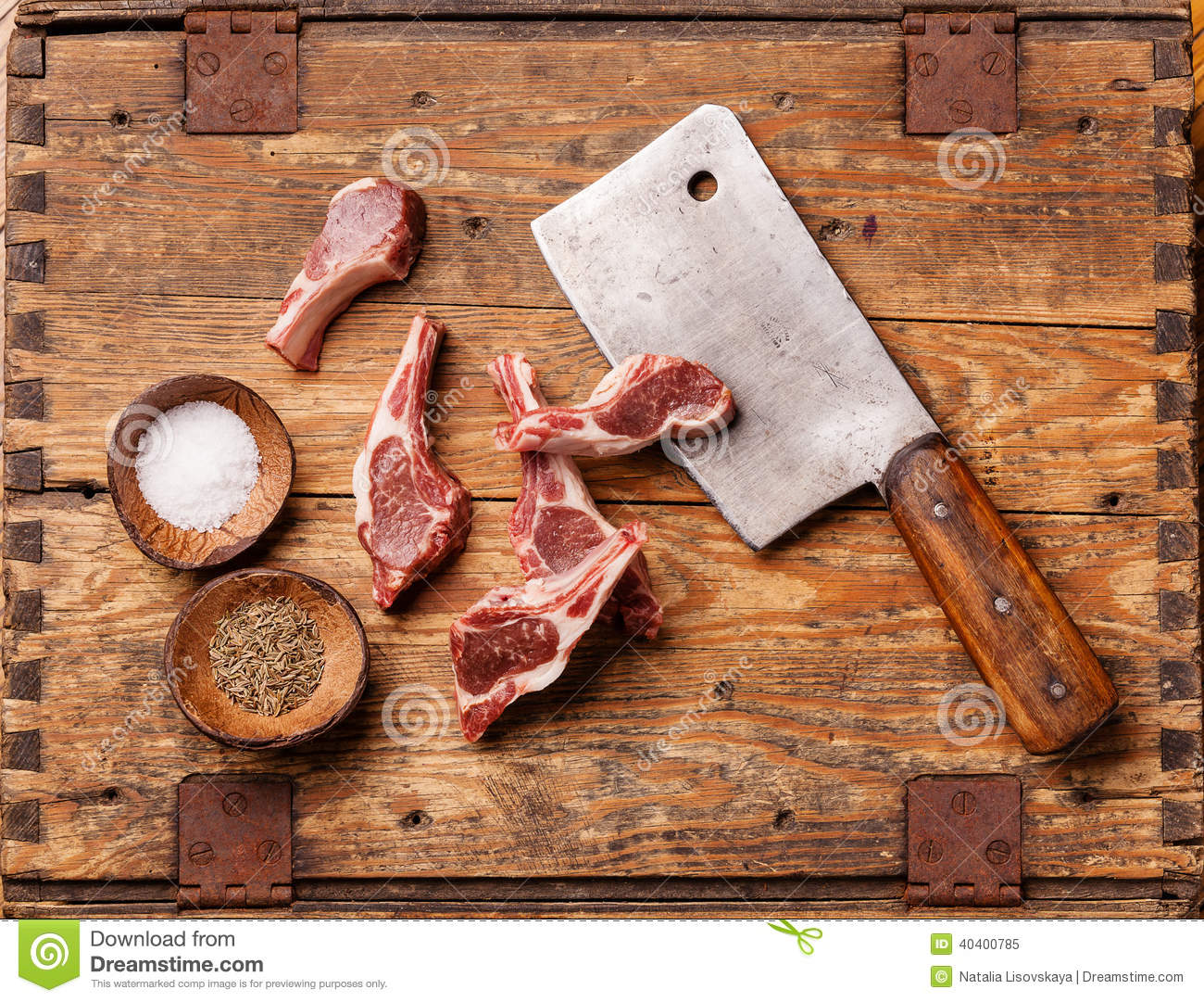 Raw lamb ribs and meat cleaver