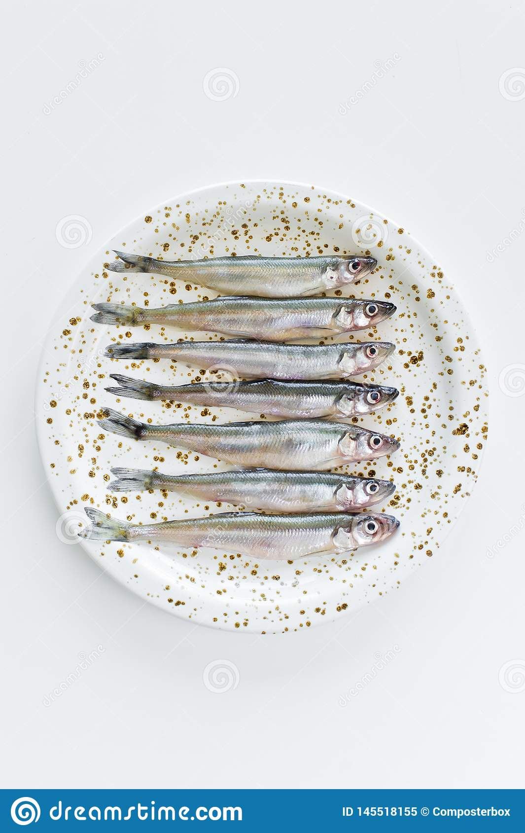 Raw mackerel on a plate. White background, top view, space for text.