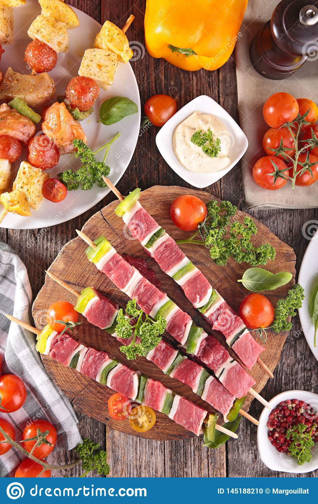Raw meat and fish skewer stock photo. Image of tomato ...