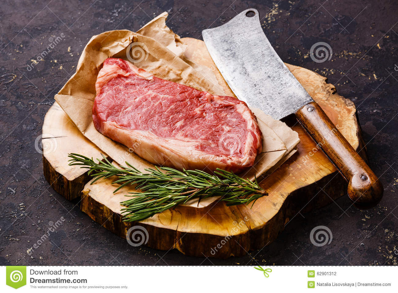 Raw meat Striploin steak and meat cleaver
