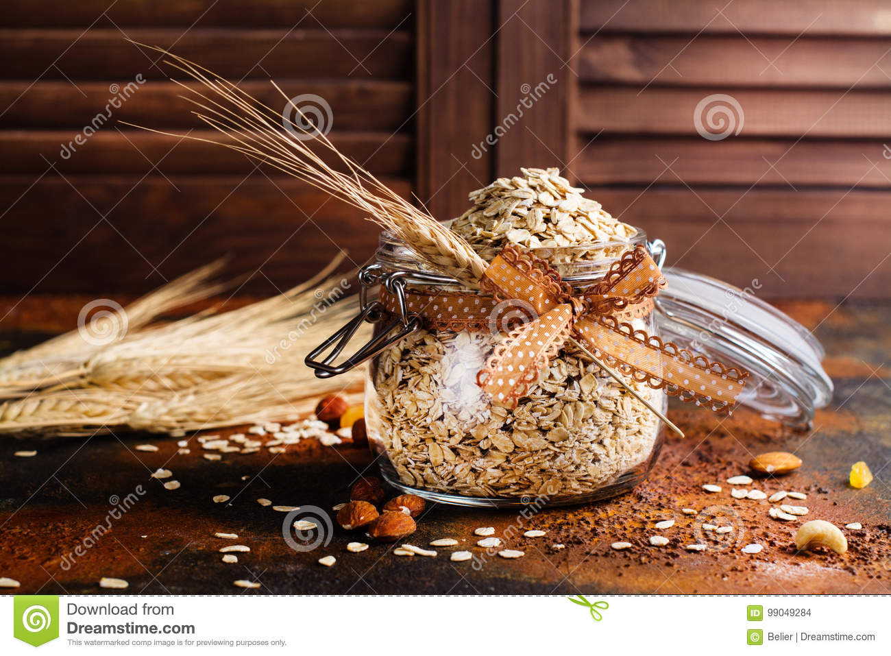 Raw Oat Meal Flakes In A Glass Jar Stock Photo