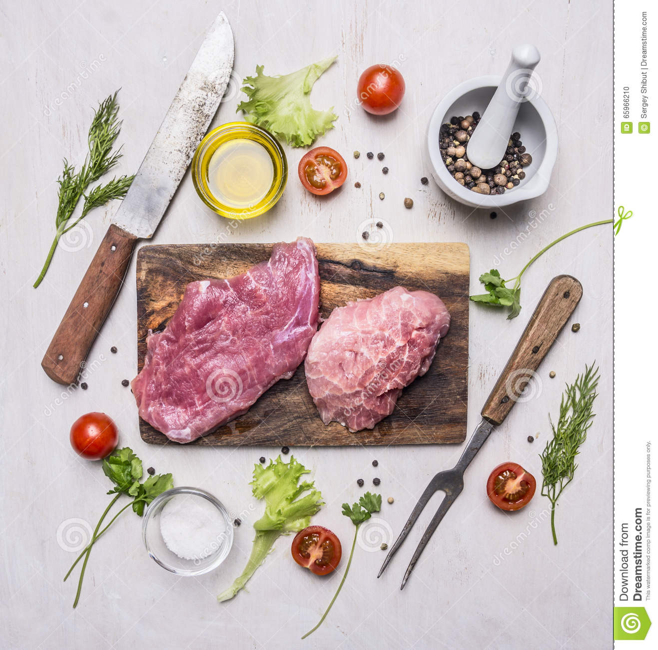 raw pork steak with vegetables and herbs meat knife and fork on a cutting board wooden rustic. Black Bedroom Furniture Sets. Home Design Ideas