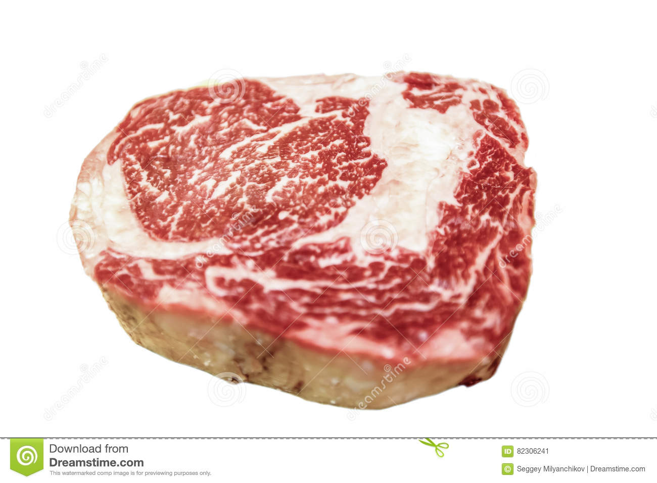 Raw ribeye beef lies on a white background. Marbled meat.