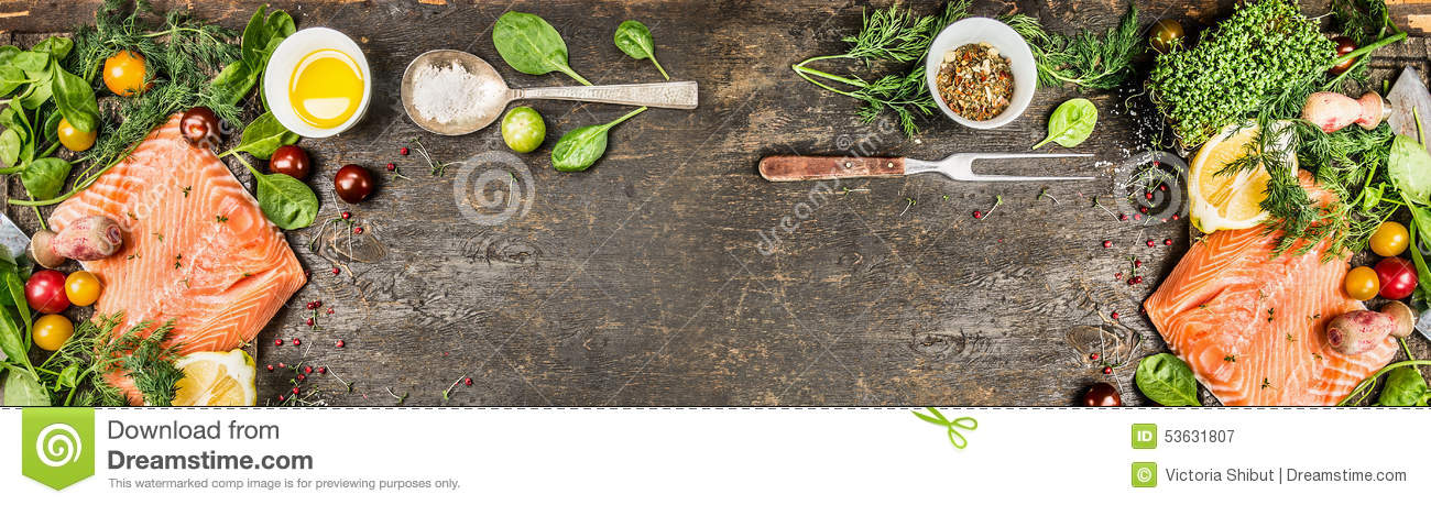 Raw salmon fillet with cooking ingredients: oil, fresh seasoning, spoon and fork on rustic wooden background, top view, banner