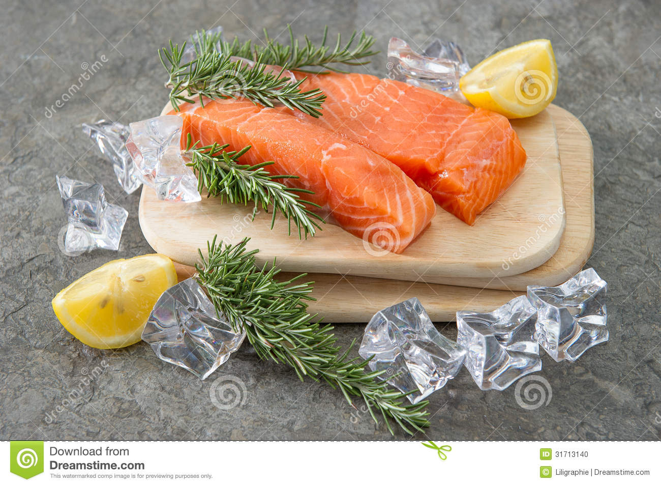 Raw salmon fillet with fresh rosemary herb lemon and ice for Salmon fish nutrition