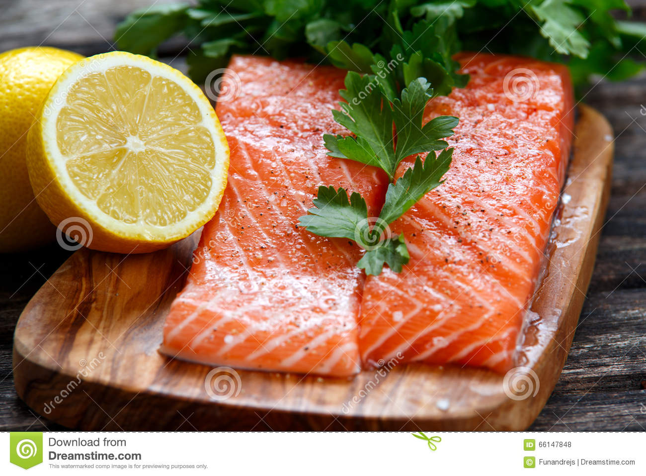 Fresh raw salmon fillet on cutting board royalty free for Fish fillet board