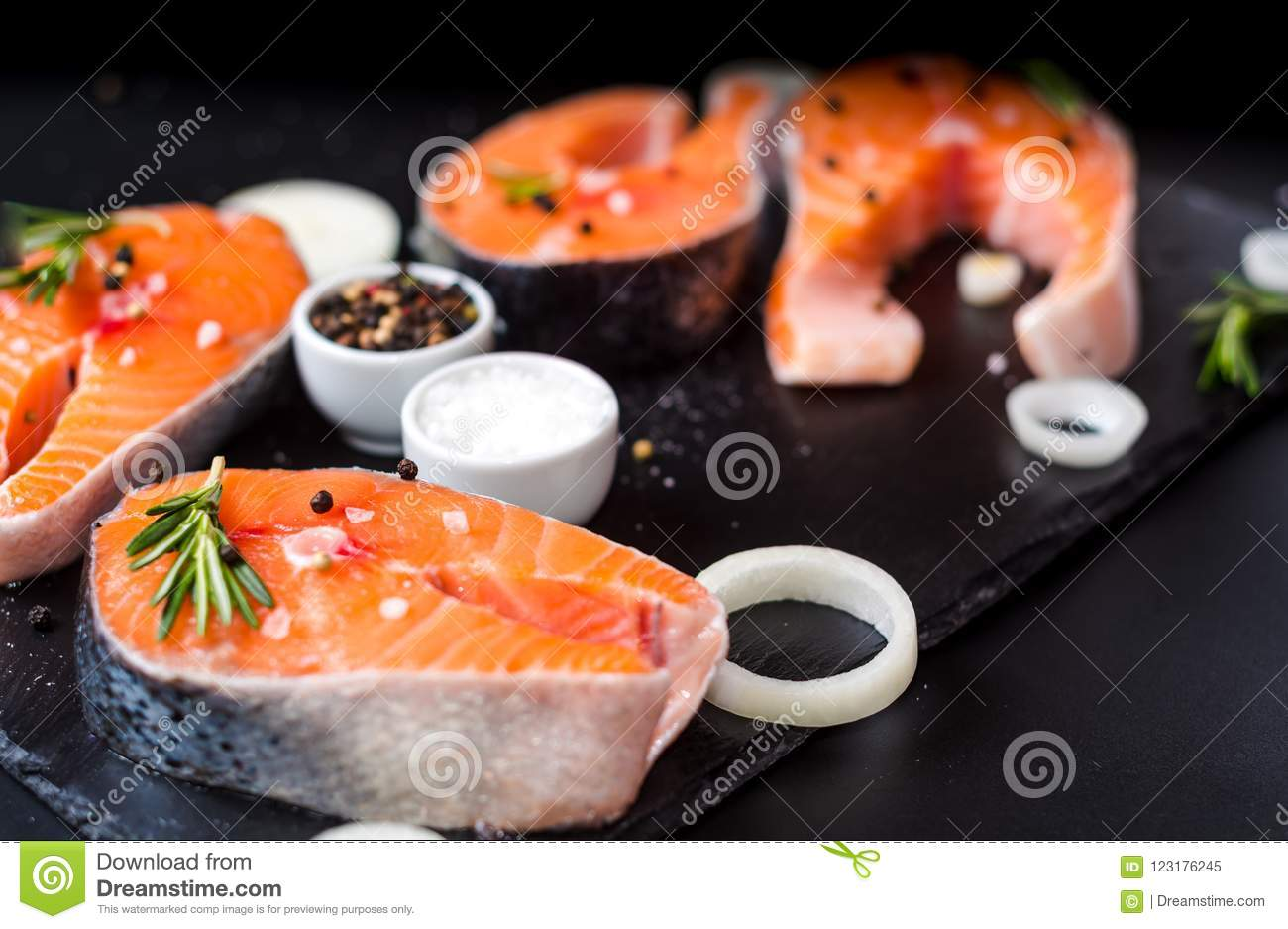 Raw Salmon Steak On Black Stone Prepared For Cooking Stock Image