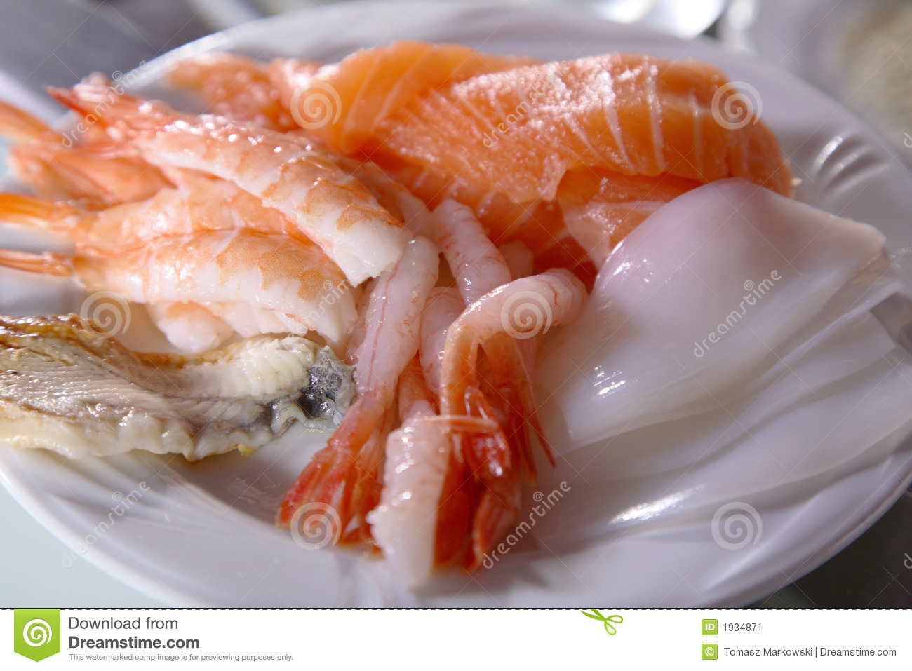plate of raw seafood, sliced and ready for use in sushi-making.