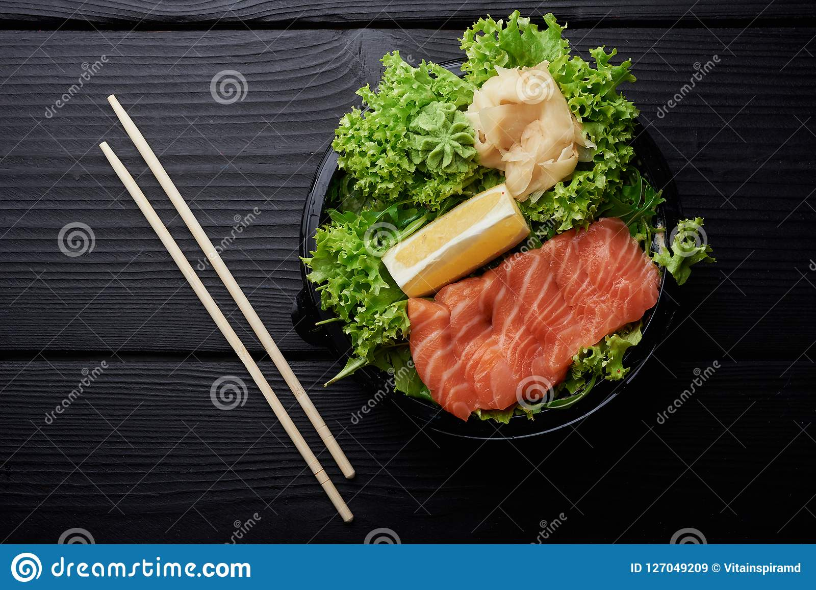 Raw Sliced Salmon Fillet on Black Stone Background. Thick Pieces of Fresh Trout. Red Fish Sashimi