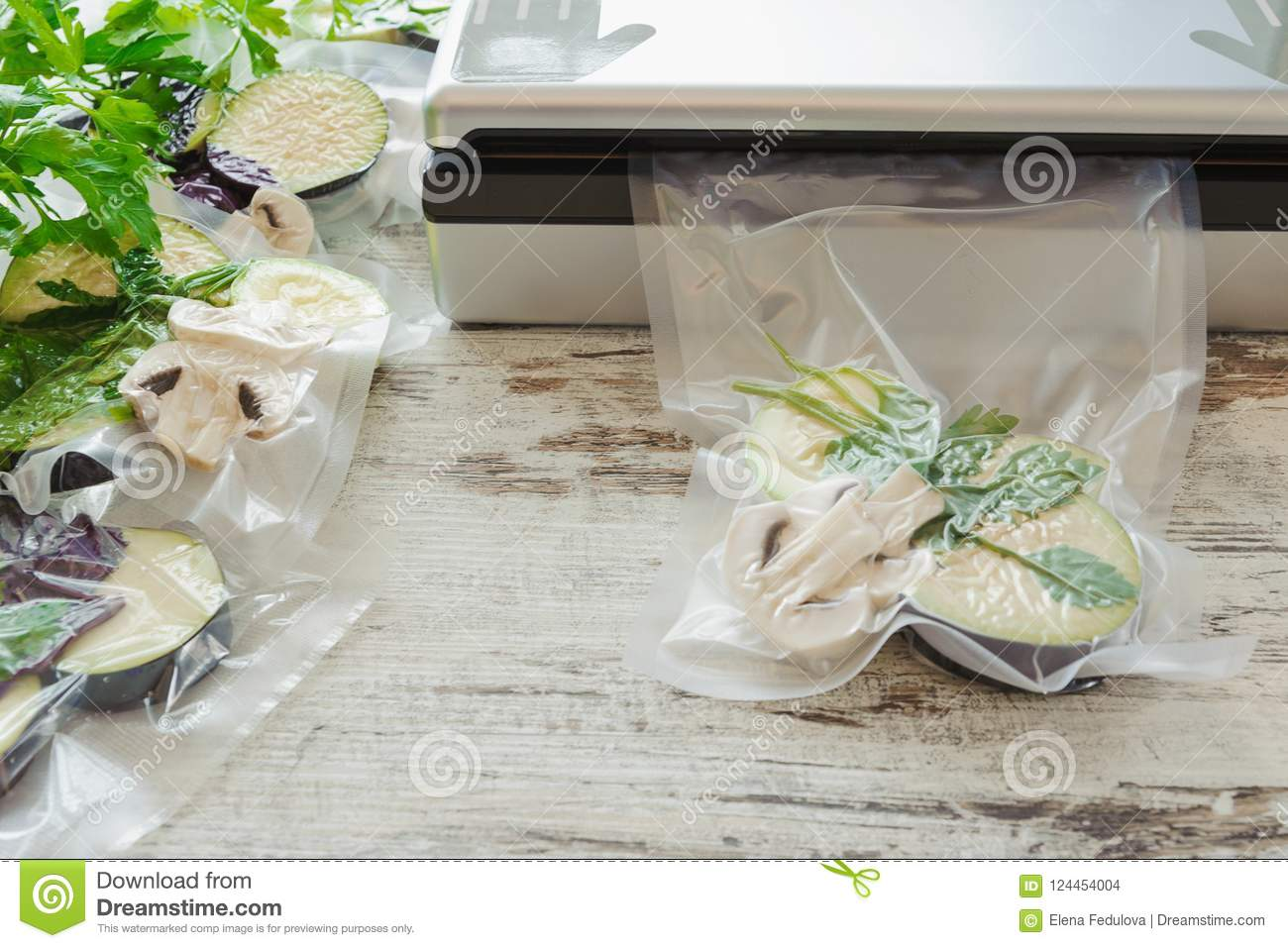 Raw vegetables and mushroom in vacuum package. Sous-vide, new technology cuisine.