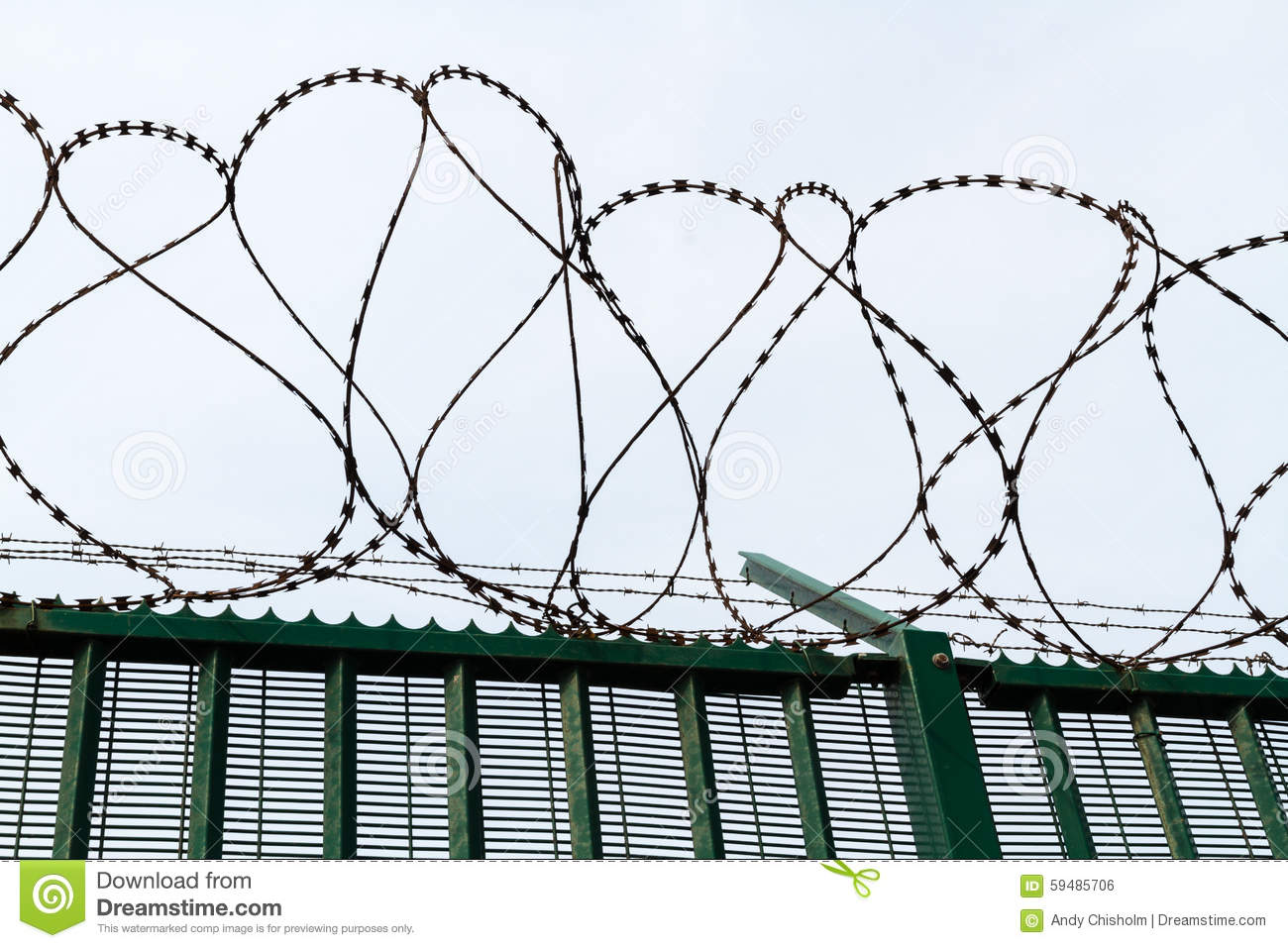 Razor Wire On Top Of Green Fence Guarding French Ferry Terminal ...