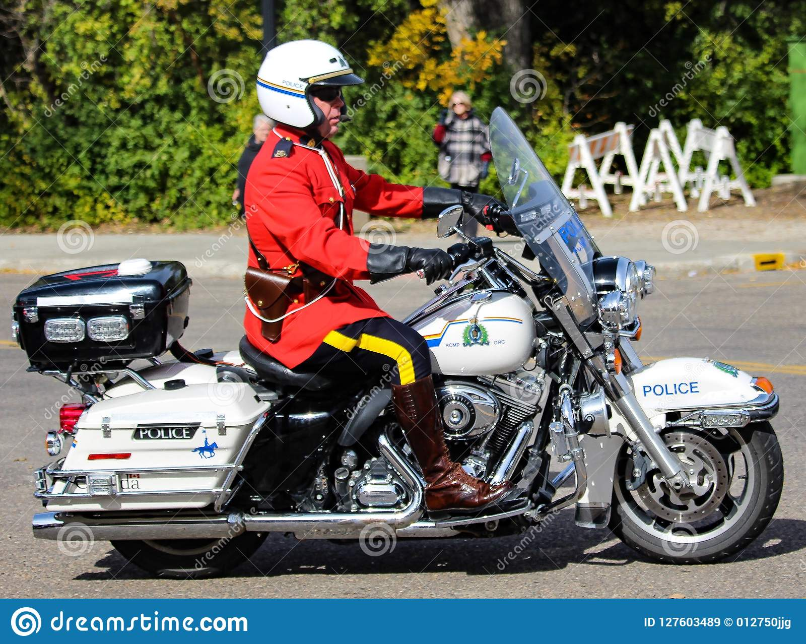 RCMP Motorcycle rider in red surge uniform