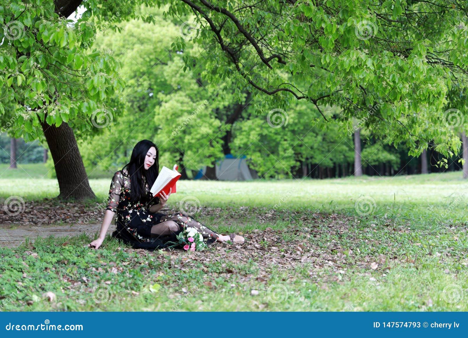 Sad Woman Sitting Under A Tree Stock Image - Image of