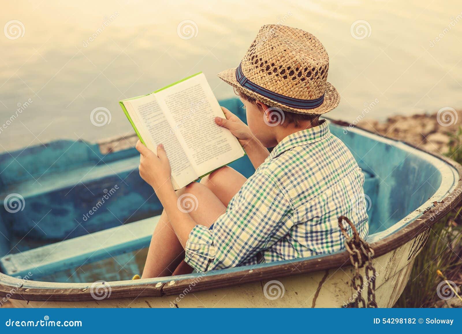 Worksheet Reading Boat reading boy in old boat stock photo image 54298182 boat