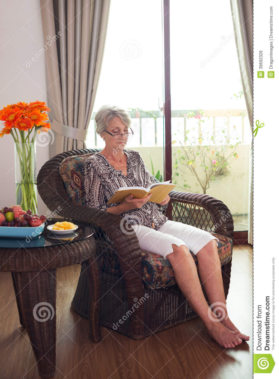 Reading in chair stock photo image 39692326 for Sitting in armchair