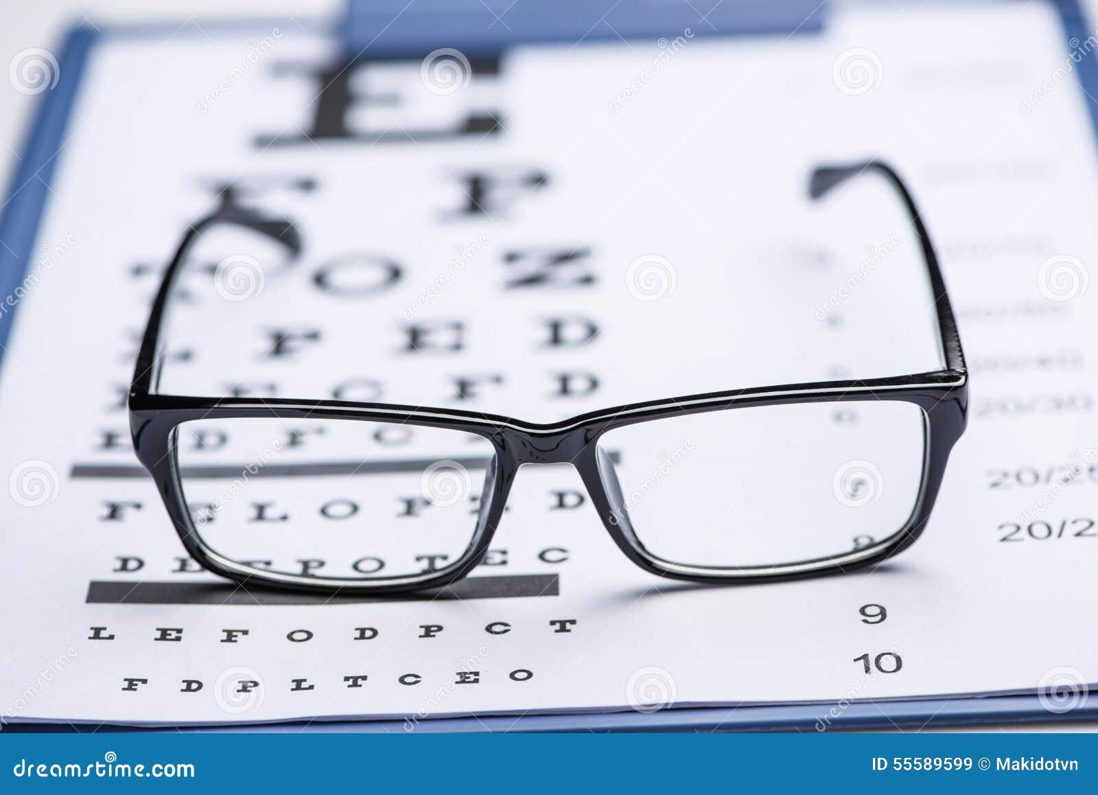 Reading Glasses On Eye Chart Stock Image Image Of Eyeglasses