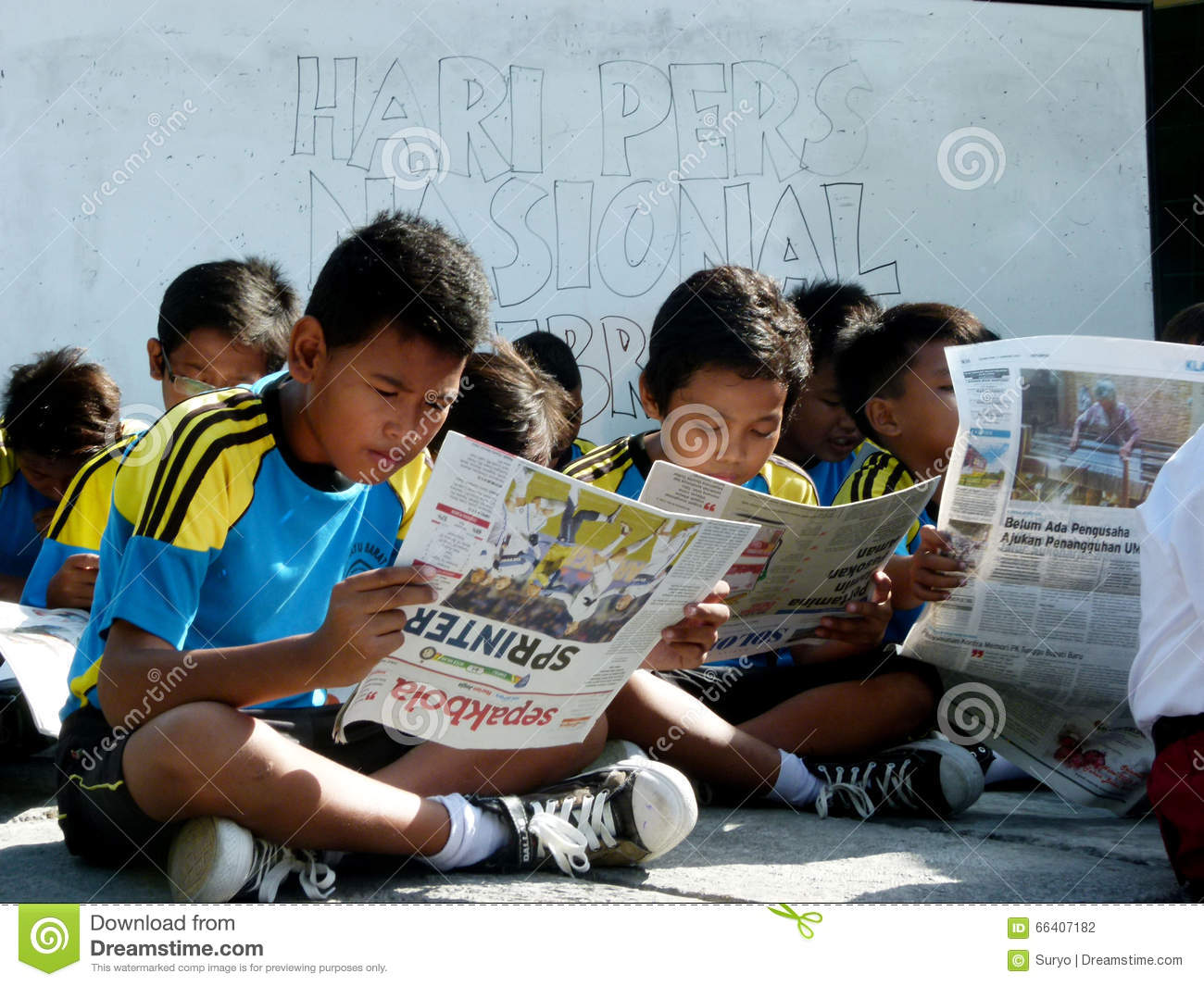 reading a newspaper editorial photography. image of school - 66407182