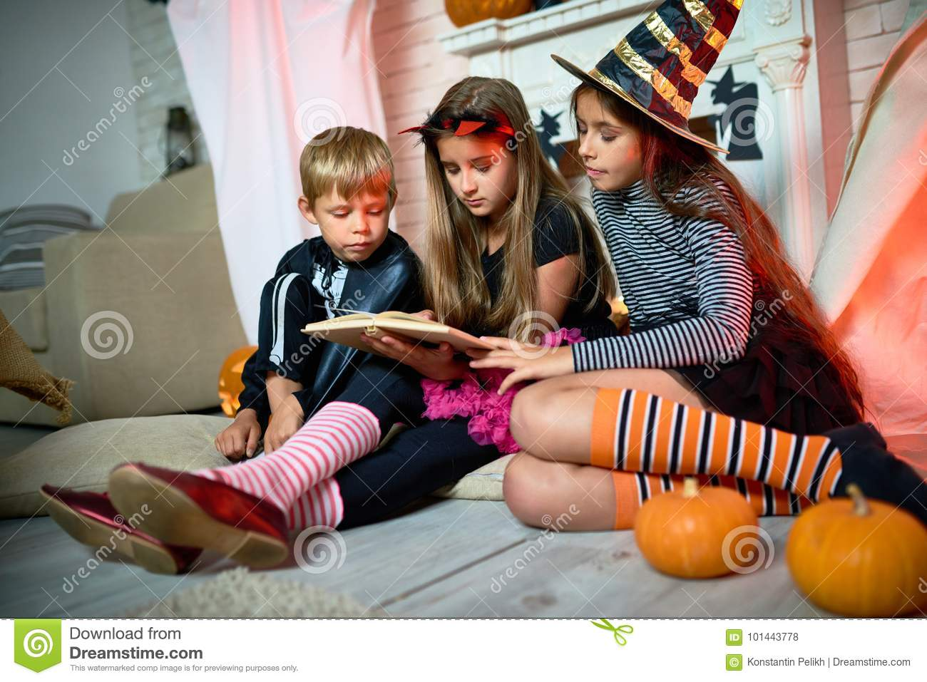 Reading Scary Stories At Halloween Party Stock Photo - Image ...
