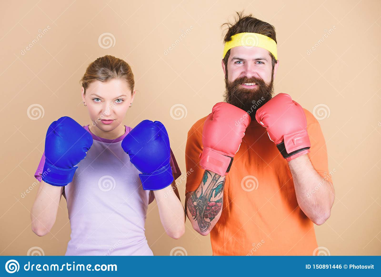 Ready to fight. Man and woman in boxing gloves. Boxing sport concept. Couple girl and hipster practicing boxing. Sport