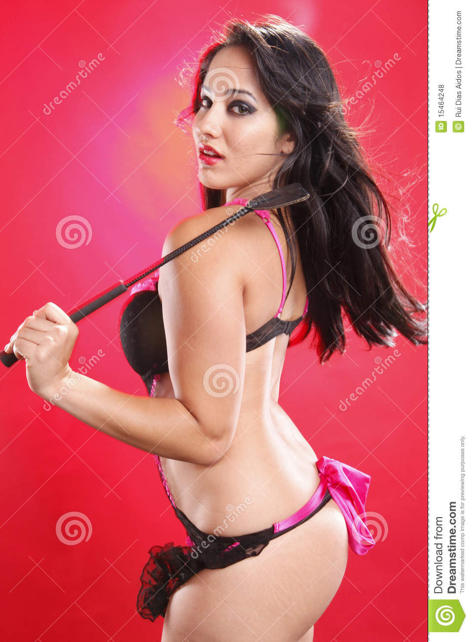 whip Brunette posing with
