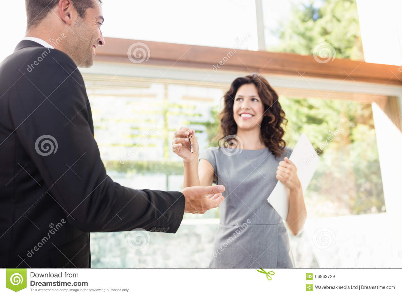 Real-estate Agent Giving Keys Stock Image - Image: 66963729