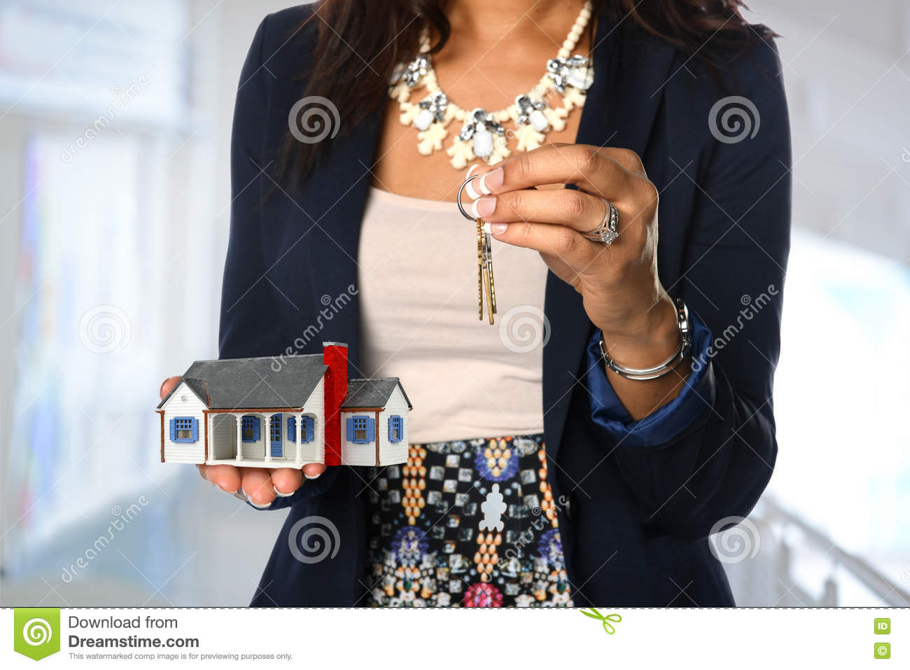 Real Estate Agent Holding House and Keys