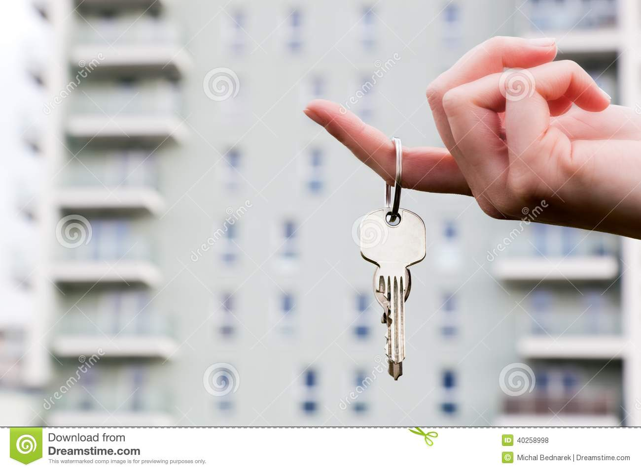 A real estate agent holding keys to a new apartment in her hands.
