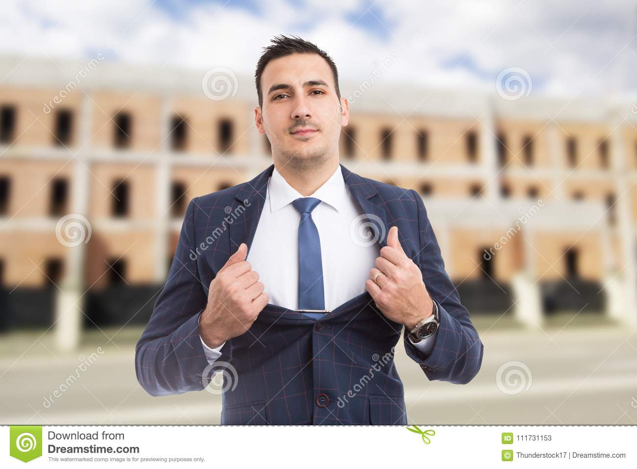 Real estate agent manager showing chest as power and success con