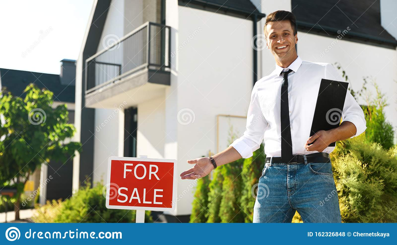Real Estate Agent Near Red Sign In Front Of House Stock ...