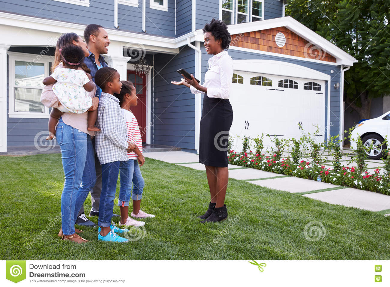 Real estate agent showing a family a house royalty free for Real time pictures of my house