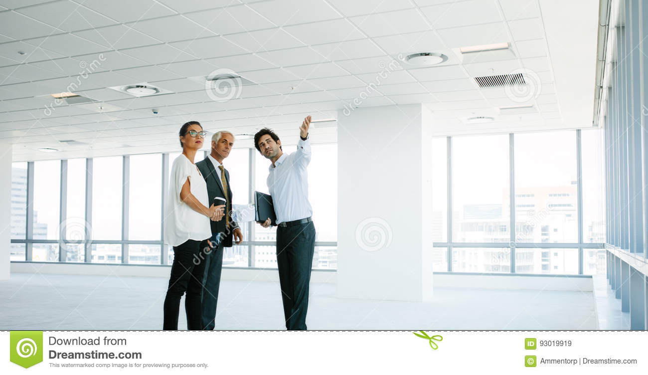 free office space. real estate agent showing new office space to clients free