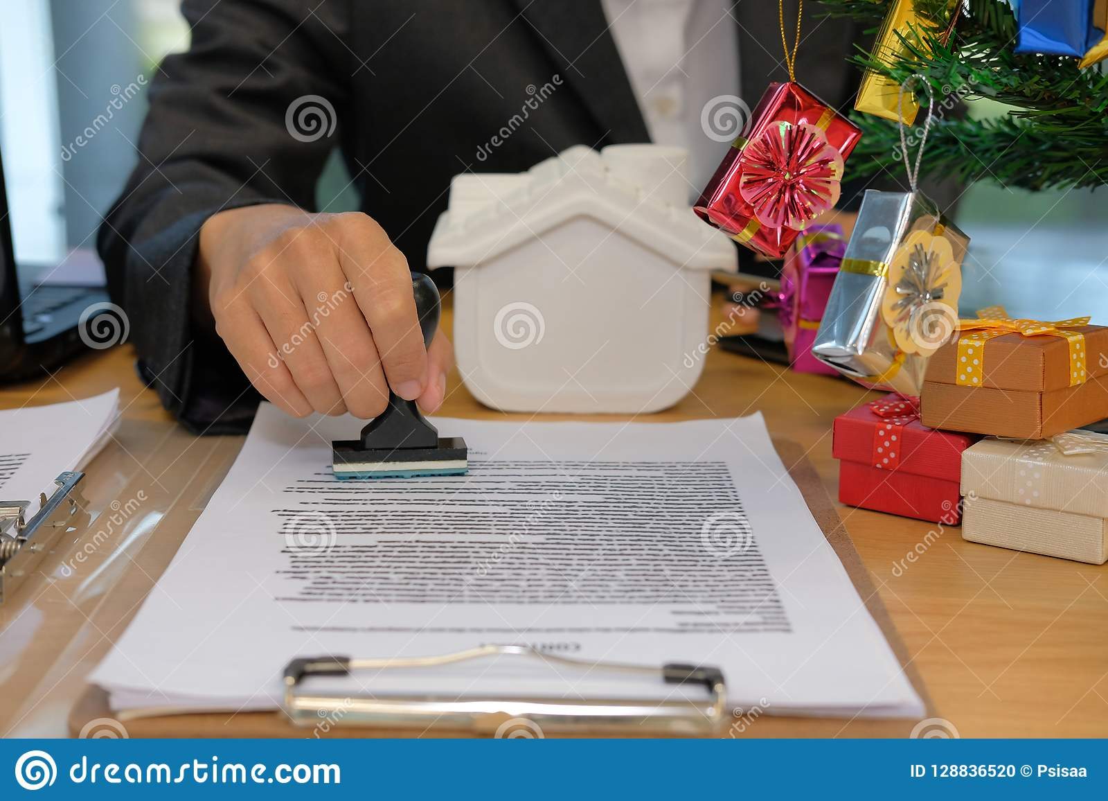 Real Estate Agent Stamping Approved On Mortgage Loan