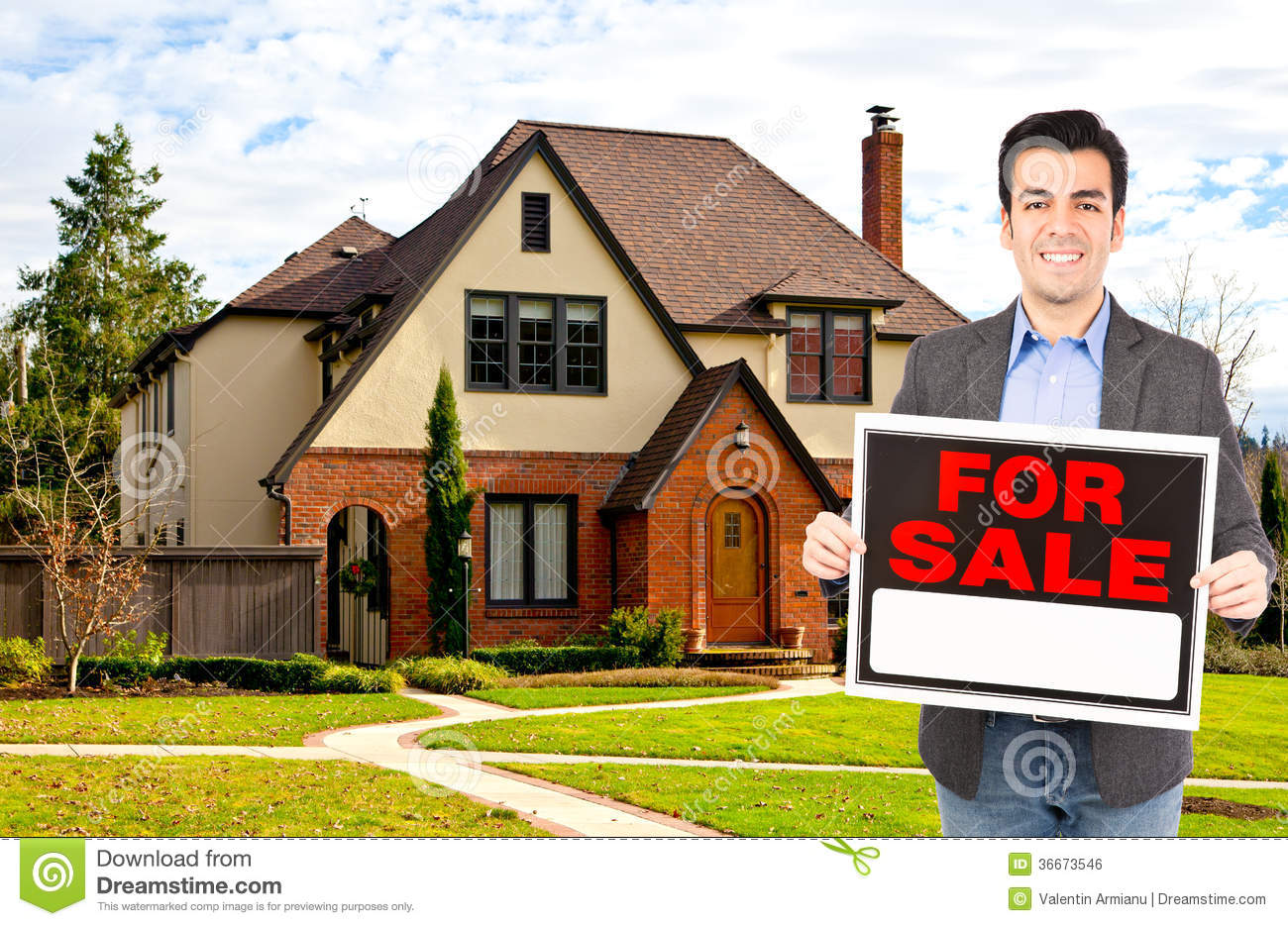 Real Estate Agent Standing Outside House Royalty Free