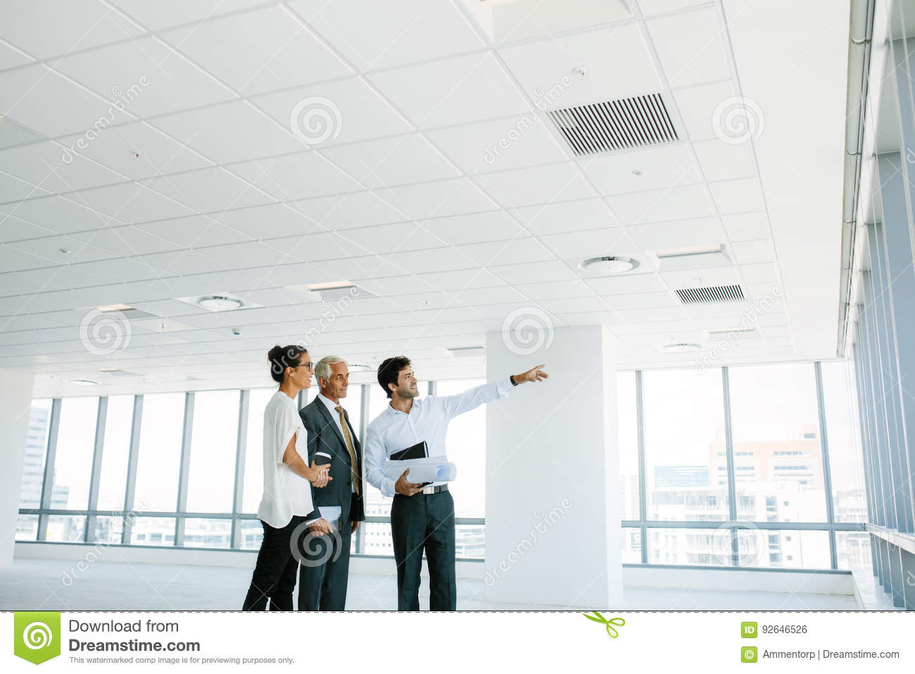 Real estate broker showing office space to clients