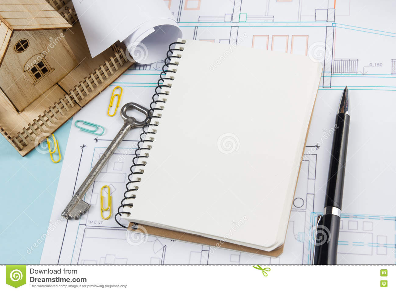 Real estate concept blank white notebook on architectural desk royalty free stock photo malvernweather Images