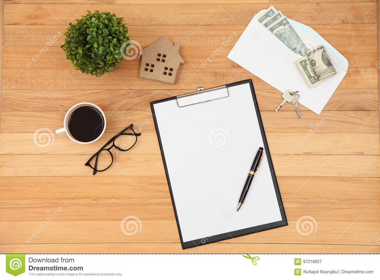 Clipboard with house icon pen eyeglasses and coffee cup on vintage royalty free stock photo malvernweather Choice Image