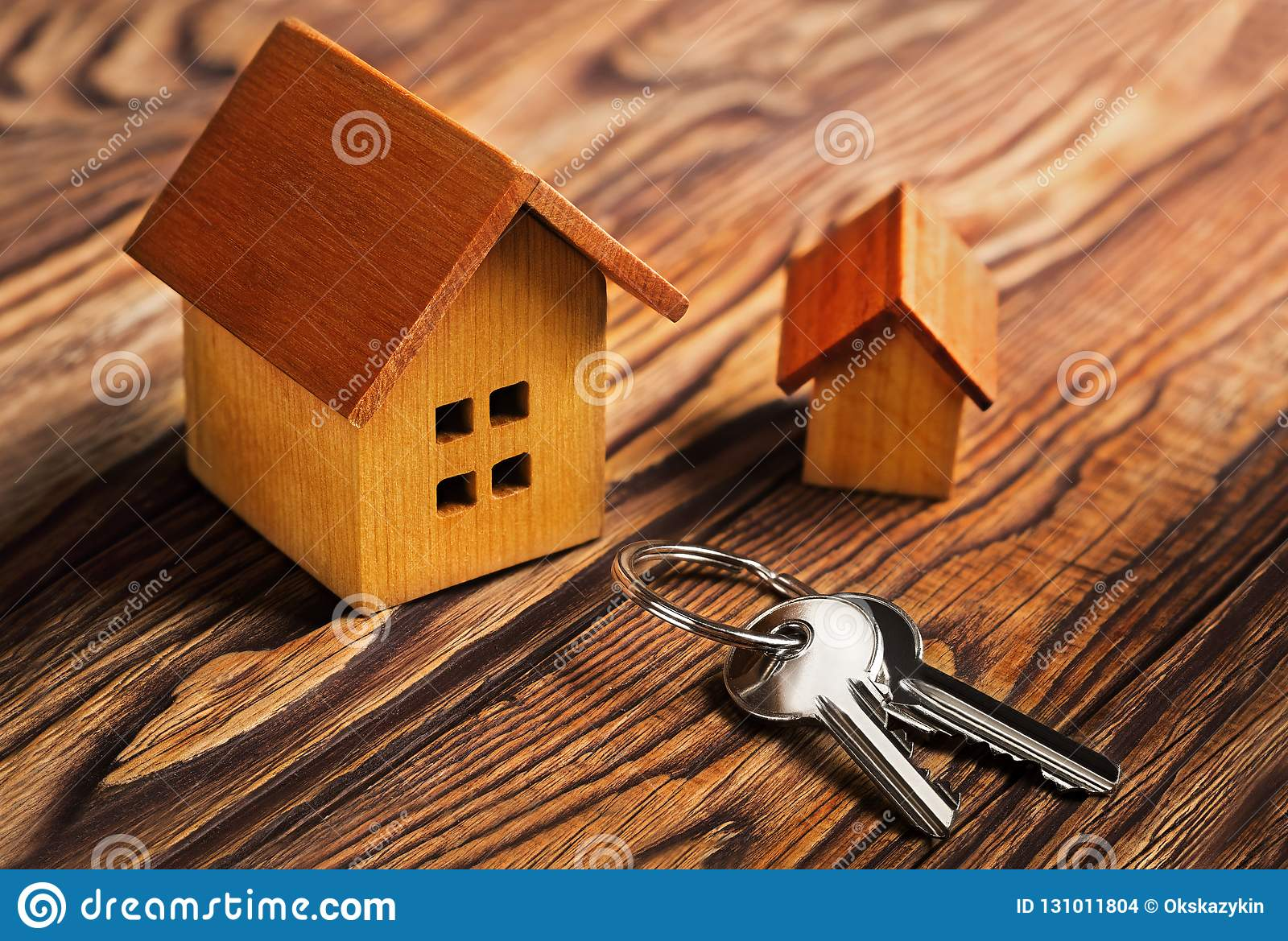 Real estate concept with house and key on wooden background. Idea for real estate concept, personal property an