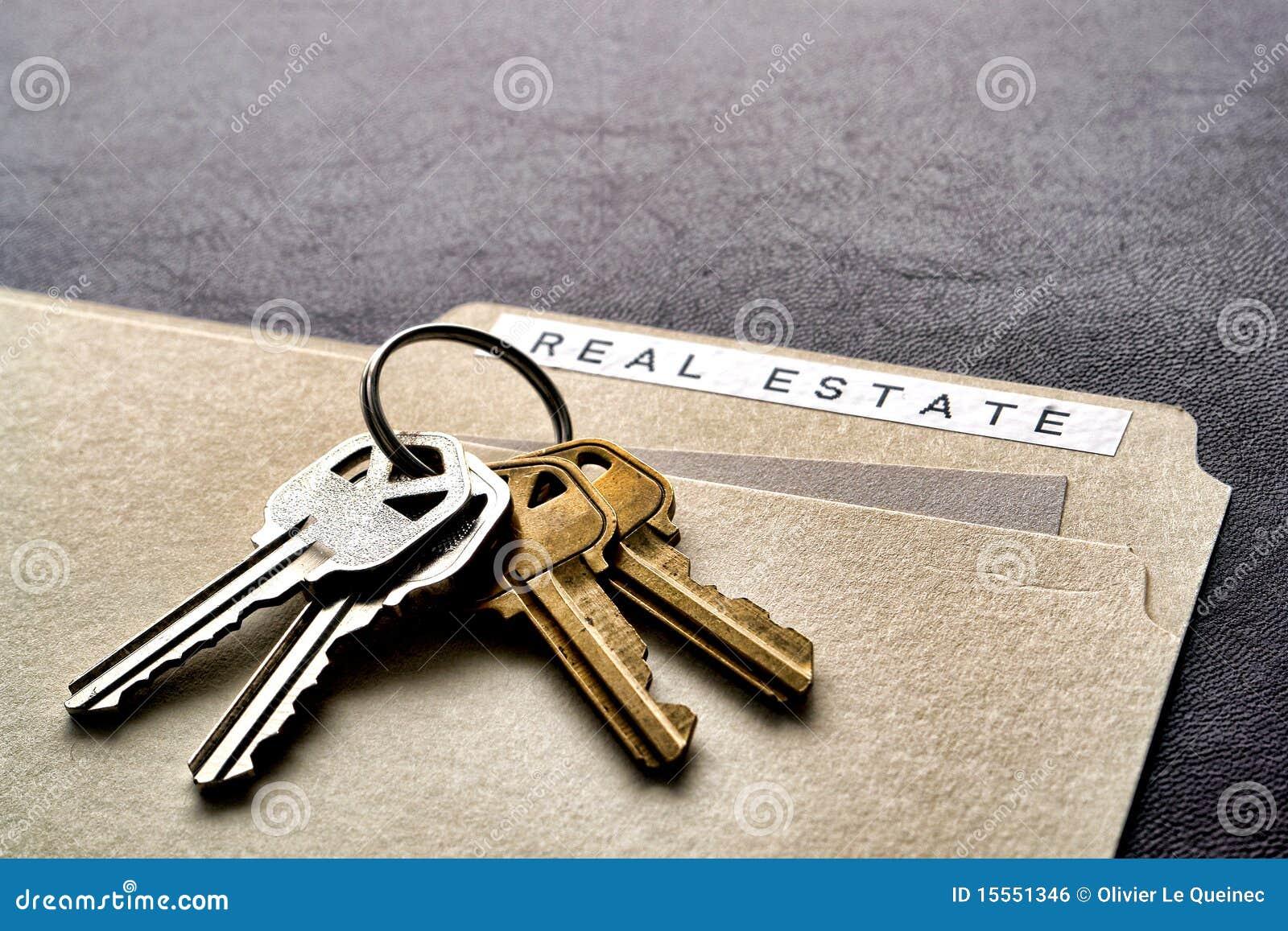 Real Estate Folder And Set Of House Keys On Desk Stock Photo